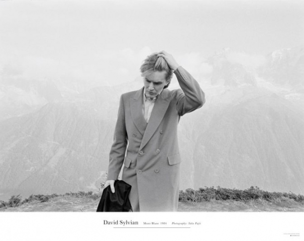 "Mont Blanc (SamadhiSound # DSP01). Official poster by Samadhi (Samadhisound # DSP01 [Poster])  Limited edition poster of the iconic image of David Sylvian, taken by Yuka Fujii on Mont Blanc in 1984, as featured on the cover of the recently released 'A Victim of Stars' compilation. this is the first occasion on which Samadhisound have produced a poster of any kind and, in this instance, with the cooperation of the somewhat reticent photographer whose permission for use of her work in this capacity is rarely granted.  Measuring 24"" x 36"", and printed on 216 gsm quality paper, the poster, designed by Chris Bigg and strictly limited to just 500 units."